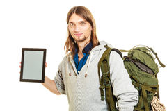 Backpacker with tablet. Blank screen copyspace. Royalty Free Stock Photos