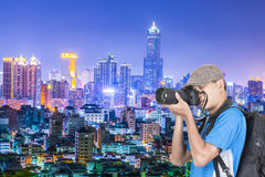 Backpacker take photo Stock Images
