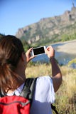 Backpacker taking photo with smartphone in Patagonia Royalty Free Stock Images