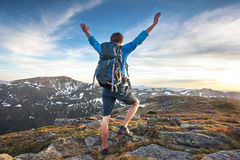 Backpacker on top of a mountaine Stock Photo
