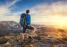 Backpacker on top of a mountaine Stock Photos