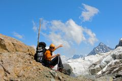 Backpacker Tourist In Mountains Royalty Free Stock Photography