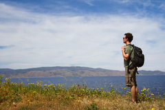 Backpacker. Tourist backpacker looking forward, summer travel Stock Photography