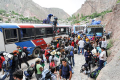 Backpacker tourists coming by bus at Iruya on the Argentina ande Royalty Free Stock Photo