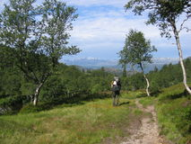Backpacker tracking in nature. A backpacker walking in the Norwegian nature Royalty Free Stock Image