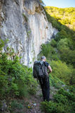 Backpacker on a trail Royalty Free Stock Photos