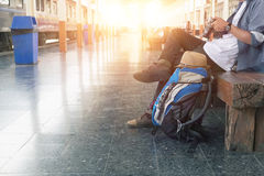 Backpacker at the train station with a traveler. Stock Images