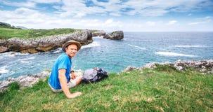 Backpacker traveler rest on the sea side Stock Photo