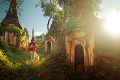 Free Backpacker Traveling  With Backpack And Looks At Sunset Ancient Stock Photo - 63543090