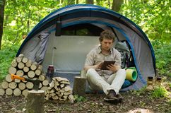 Traveller Uses A Tablet Outdoors. Stock Photography