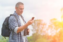Backpacker using smart phone Stock Photos