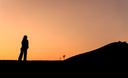 Backpacker walking on the mountain Royalty Free Stock Images