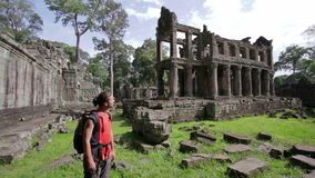 Backpacker walking in preah khan temple, angkor, cambodia stock video