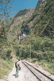 Backpacker walking on the railroad track to Machu Picchu, Peru, alternative to the usual tourist train connection. Machu Picchu ar stock images