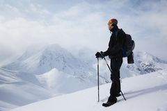 Backpacker in winter mountains Royalty Free Stock Image