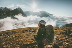 Backpacker woman observing mountains clouds Royalty Free Stock Photography