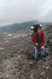 Backpacker a young man in mountains Stock Photos