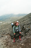Backpacker a young woman climbing Royalty Free Stock Photography
