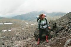 Backpacker a young woman climbing Stock Photo