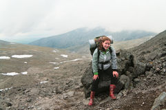 Backpacker a young woman climbing Stock Image