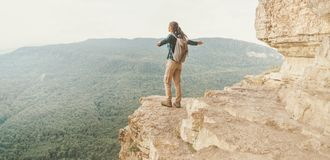 Happy explorer on cliff Eagle shelf. Royalty Free Stock Images