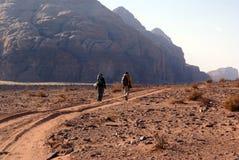 Backpackers. On the treck in Wadi Rum desert, Jordan Stock Photography