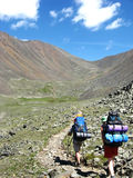 Backpackers. Trekking on siberian high mountain Royalty Free Stock Image