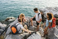 Backpackers on an adventure. Together royalty free stock photo