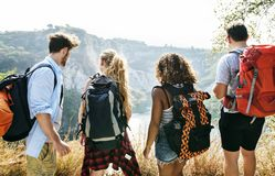 Backpackers on an adventure together in summer stock photos