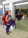 Backpackers at airport Stock Photo