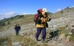 Backpackers on Alpine Route Stock Photo