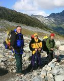 Backpackers on an Alpine Trail Royalty Free Stock Photo