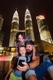 Backpackers in a big city. Family of three happy and excited together for the Malaysia trip. Holiday vacation, traveling abroad stock images