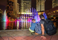 Backpackers in a big city. Father and son happy and excited together for the Malaysia trip. Having fun, taking selfies. Holidays. Backpackers in a big city Stock Photo