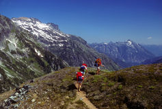 Backpackers crossing Cascade Pass Stock Photography