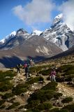 Backpackers in the Everest base camp trail. Group of backpackers with the mountains of the Everest base camp trek in Nepal Stock Images