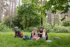 Backpackers family dining in nature Royalty Free Stock Photography