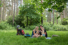 Backpackers family dining in nature Royalty Free Stock Photos