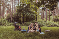 Backpackers family dining in nature Stock Photography