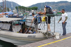 Backpackers getting to a boat Stock Image