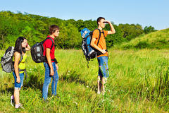 Backpackers hiking. Three teenage fellow backpackers hiking stock photography
