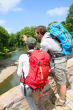 Backpackers on hiking journey in preserved nature royalty free stock images