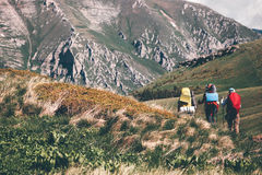 Backpackers hiking in mountains. Travel Lifestyle concept adventure active vacations outdoor scenic landscape on background royalty free stock photography