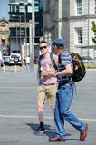 Backpackers with ice creams, Liverpool. Royalty Free Stock Photo