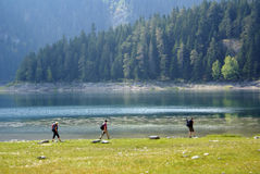 Backpackers jn the bank of Black lake, Dormitor Royalty Free Stock Photography