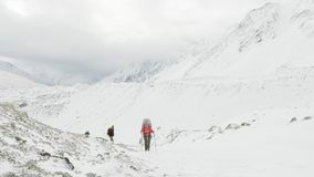 Backpackers on Larke Pass in Nepal, 5100m altitude. Manaslu circuit trek area.