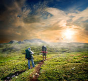 Backpackers in mountains Stock Photo