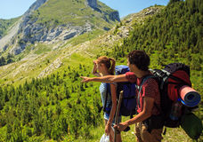 Backpackers in Mountains Royalty Free Stock Photography