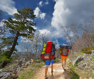 Backpackers in mountains Stock Photos