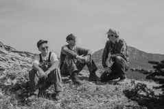 Backpackers resting on the crest of the Swan mountain Range. Bla Royalty Free Stock Images